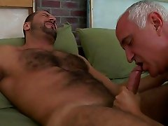 An old man is sucking his fellows dick passionately