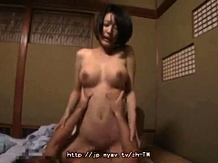 Busty Asian milf has a stiff cock making her peach all wet