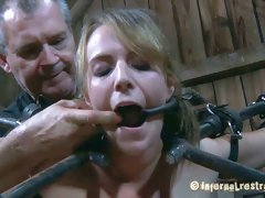 Awesome BDSM bars lock Alisha Adams in the spider position
