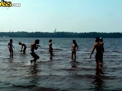 Salty Russian harwlos play volleyball at the beach in bikini