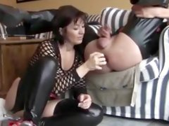 A woman does a prostate massage at her slave using