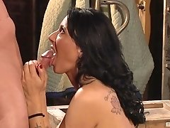Brunette MILF slut Zoey Holloway deepthroats a cock and rides it after