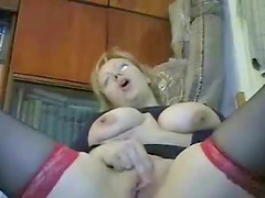 Busty blonde milf slut showing her huge boobs on cam