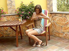 Lewd brown-haired chick smashes her snatch with a dildo outdoors