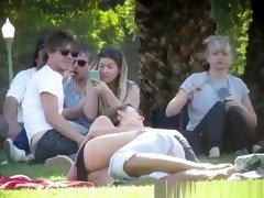 Girl lying down in grass crotch upskirt