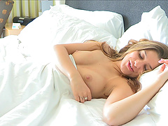 Gorgeous blonde teases and fingers her smooth shaved pussy