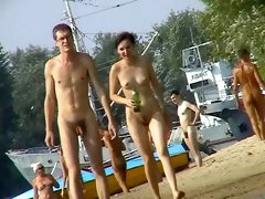 Nude beach spy camera with a sexy couple in focus