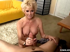 Mature blonde vixen likes to have some fun with a rock hard dick, in her living room