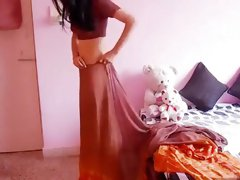 Hot Housewife Wearing Saree And Showing Navel