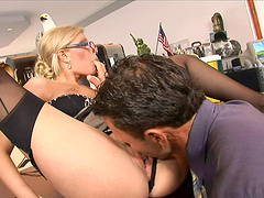 Attractive blonde in thong moaning while riding huge dick hardcore in the office