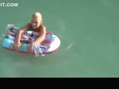 Hot blonde nudist woman swimming