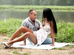 Romantic couple having sensual sex near the lake