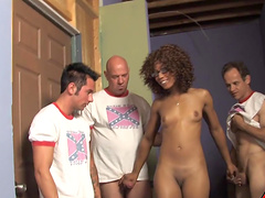 Ebony in glasses enjoys cum in mouth in an interracial gangbang