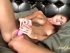 A pink vibrator is all the sexy milf needs
