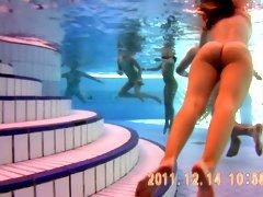 Underwater scenes of the nude chicks in the sauna pool