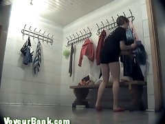 Pale skin and bronze skin ladies in the locker room chaning clothes