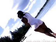 Curvy black girl jogs down the beach