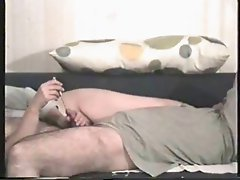 She uses a vibrating sound and makes him cum